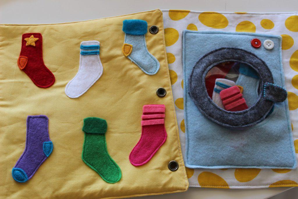 libro tattile lavatrice calzini